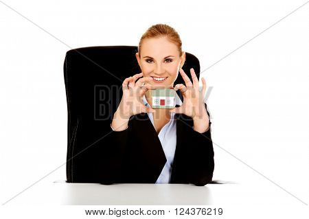 Young business woman presenting a house model