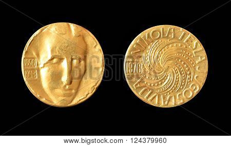 YUGOSLAVIA - CIRCA 1976 : Gold medallion, made by Zlatara Majdanpek - Yugoslavia, that shows portrait of scientist Nikola Tesla.