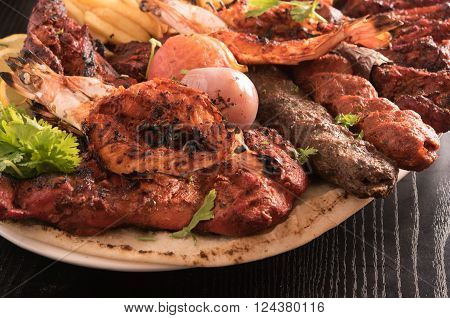 Mixed Grilled meat and vegetables in a restaurant