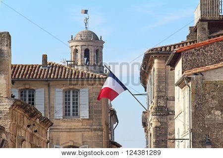 French architecture detail with French flag flaunting