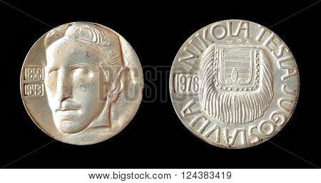 YUGOSLAVIA - CIRCA 1976 : Silver medallion, made by Zlatara Majdanpek - Yugoslavia,  that shows portrait of scientist Nikola Tesla.