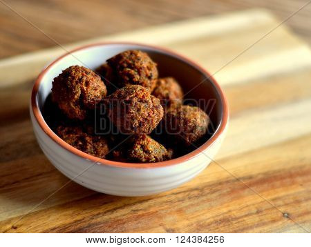 Falafel: falafel balls in a dish, appetizer