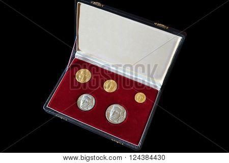 YUGOSLAVIA - CIRCA 1976 : Set of gold and silver medallions, made by Zlatara Majdanpek, Yugoslavia, that show portrait of scientist Nikola Tesla.