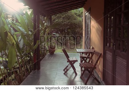 Brazil traditional house. table and chairs on the terrace at dawn. Brasil