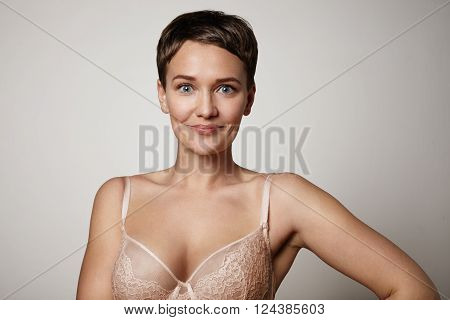 Happy Smiling Woman Wears Bra. Big Size Of Bra Concept.