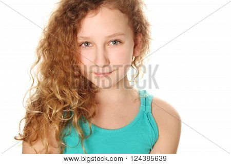 Beautiful teenage girl smiling on white background