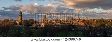 Shrewsbury panorama showing the church spires of St. Chad's, St. Mary's, St. Alkmund's and the cathedral, in golden evening light.
