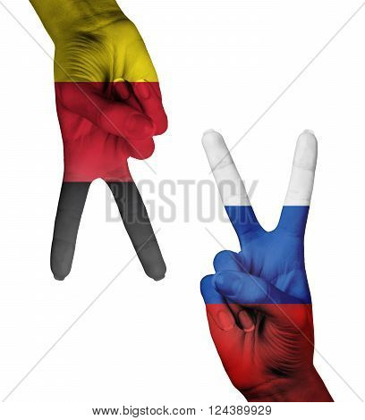Hands making the V sign as symbol of victory. Russia and Germany flags painted on hands isolated on white background