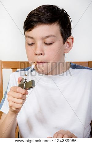 Young boy lighting a cigarette with a lighter