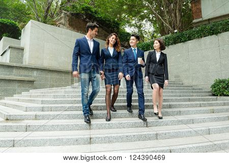 Group of business people walking down stair in Hong Kong central business district