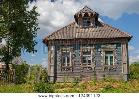 facade of the old building collapsing Russian peasant house