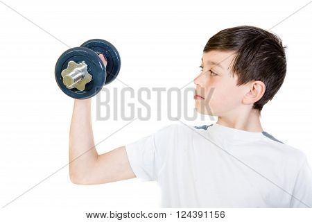 Young boy lifting a dumbbell exercing his arm
