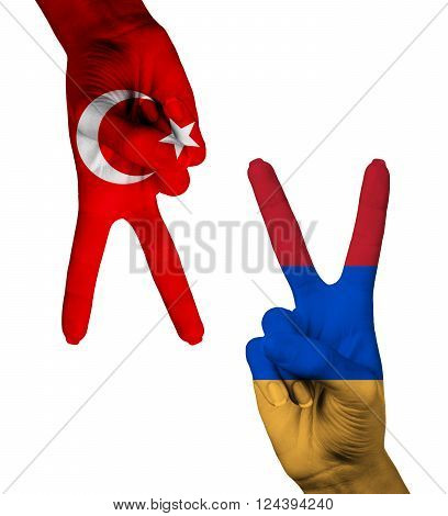 Hands making the V sign as symbol of victory. Russia and Turkey flags painted on hands isolated on white background