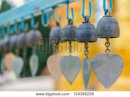 Row of golden bells in buddist temple at Thailand.