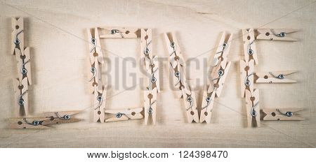 love written in small wooden clothes pegs