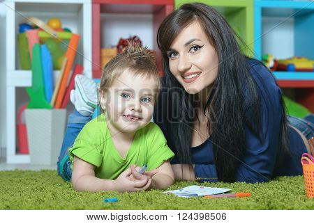 cute little boy  with mother at home or kindergarten