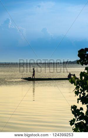 fisherman on wook boat at songkhla lake