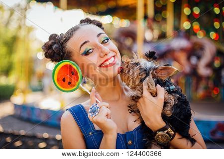 Bright Makeup Beautiful Girl With Yorkshire Terrier Holding Watermelon Lollipop.