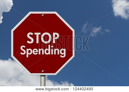 Stop Spending Road Sign Red and White Stop Sign with words Stop Spending with sky background