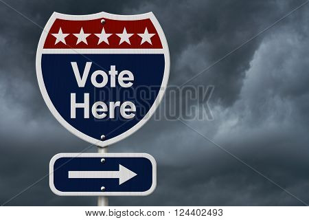 American Vote Here Highway Road Sign, Red, White and Blue American Highway Sign with words Vote Here with stormy sky background