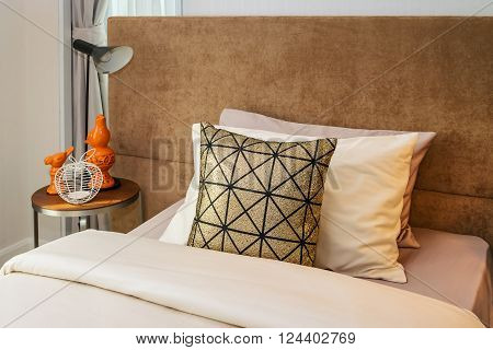 single bed with bedside tables and reading lamp