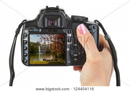 Camera in hand and Madrid view (my photo) isolated on white background