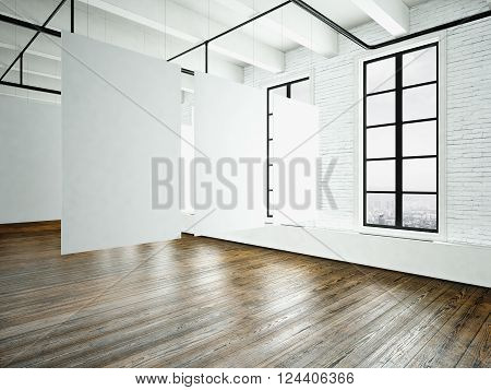 Image loft expo interior in modern building.Open space studio.Empty white canvas hanging.Wood floor, bricks wall, panoramic windows.Blank frames ready for bussiness information.Horizontal. 3D rendering