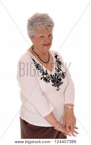 A retired senior woman looking at the camera in a sceptical look can not