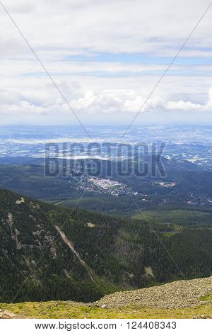 Background beautiful layered mountain landscape with hills and sky view from the top of Snezka mountain on the border of Poland and the Czech Republic ** Note: Visible grain at 100%, best at smaller sizes