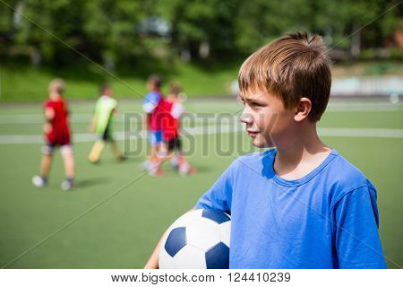 Young soccer player in training on a soccer field