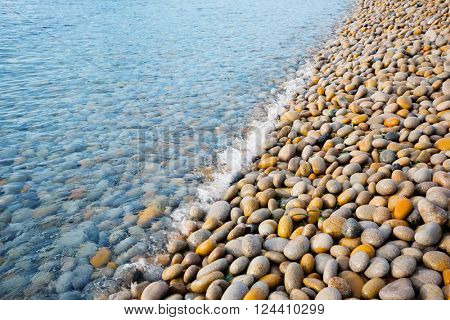 Large pebbles on the seashore in the early morning