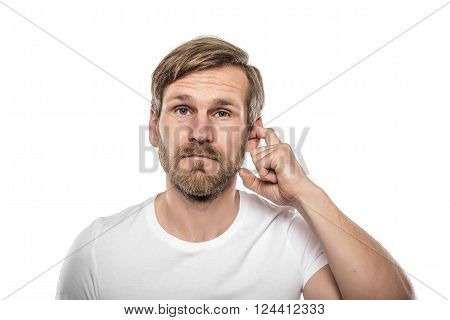 Man Scratching in His Ear. Isolated on white.