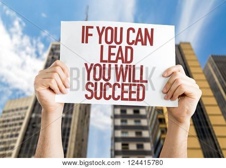 If You Can Lead You Will Succeed placard with urban background