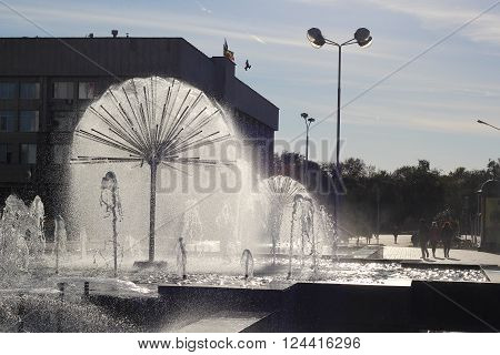 A beautiful fountain in the form of a ball on the square in the old town