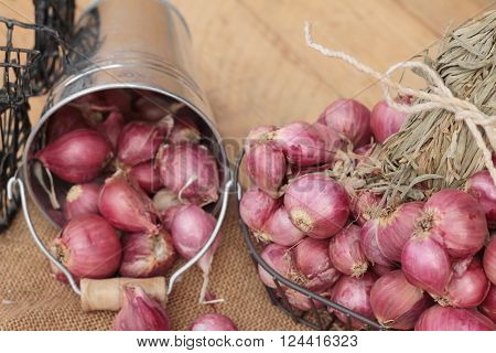 raw shallots for cooking on wood background ** Note: Soft Focus at 100%, best at smaller sizes