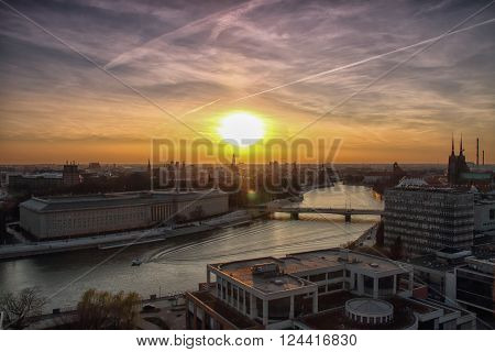 WROCLAW POLAND - APRIL 02 2016: Aerial view of Wroclaw. City skyline Churches on Ostrow Tumski island over Odra river during a beautiful sunset April 02 2016 in Wroclaw Poland.