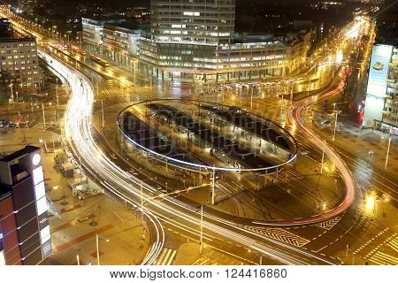 WROCLAW POLAND - MARCH 7 2016: Traffic roundabout shot with long exposure time at night Grunwaldzki Square March 7 2016 in Wroclaw Poland.