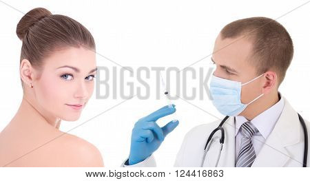plastic surgery - doctor in mask and blue gloves with syringe and woman patient isolated on white background