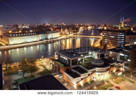 WROCLAW POLAND - MARCH 21 2016: Aerial view of Wroclaw. Illuminated city skyline at night March 21 2016 in Wroclaw Poland.