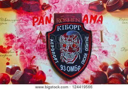 ILLUSTRATIVE EDITORIAL.Chevron of Ukrainian Army. With logo Roshen Inc. Trademark Roshen is property of Ukrainian president Poroshenko.At February 20,2016 in Kiev, Ukraine
