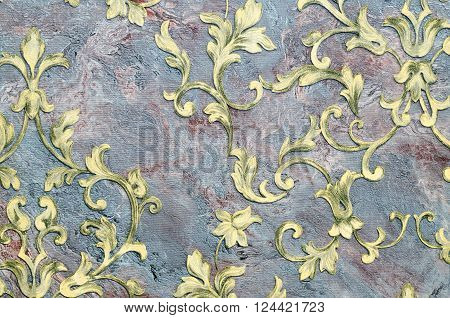Seamless golden pattern on fabric as background.