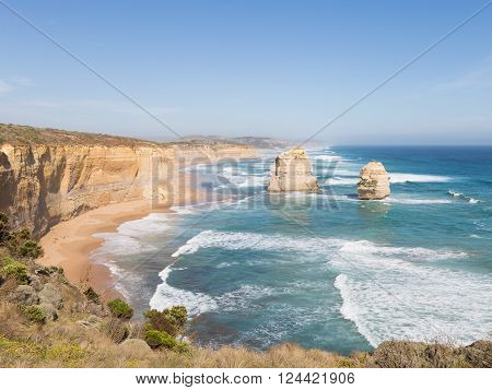 salty sea waves run on the beautiful rocky coast of large stones along the Great Ocean Road and rocks 12 Apostles Victoria Australia