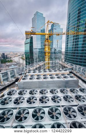 MOSCOW, RUSSIA - AUG 30, 2015: Air conditioners, crane and Moscow International Business Center including 20 futuristic buildings