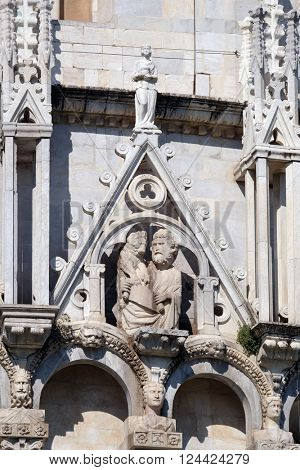 PISA, ITALY - JUNE 06, 2015: Saint Mark the Evangelist, Baptistery decoration architrave arches, Cathedral in Pisa, Italy. Unesco World Heritage Site, on June 06, 2015