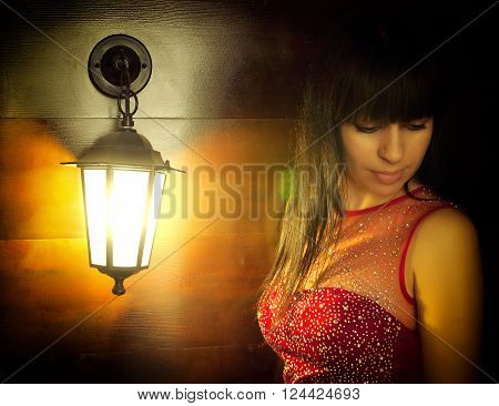 Beautiful girl brunette lantern light lit lowered her eyes