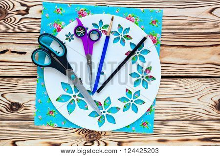Master Class. Watch handmade. Step by step instructions for manufacture of clocks. Scissors and brush. Painted white base clock with decorative holes. Detail of turquoise fabric for the background.