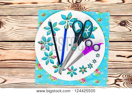 Watch handmade. Master Class. Step by step instructions for manufacture of clocks. Scissors and brush. Painted white base clock with decorative holes. Detail of turquoise fabric for the background.