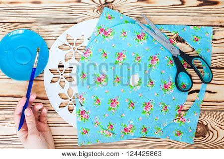 Master Class. Watch handmade. Step by step instructions for the manufacture of clocks. Detail of turquoise fabric for the background, glue and a brush. Painted white base clock with decorative holes.