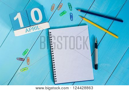 April 10th. Image of april 10 wooden color calendar on blue background.  Spring day, empty space for text. International Day Of resistance movement.