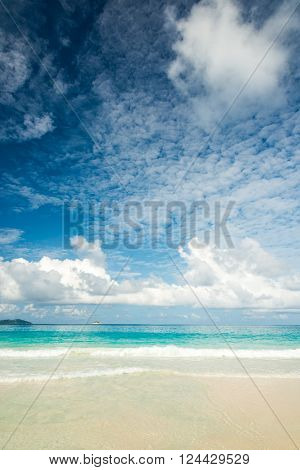 abstract beach with turquoise sea and cloudscape